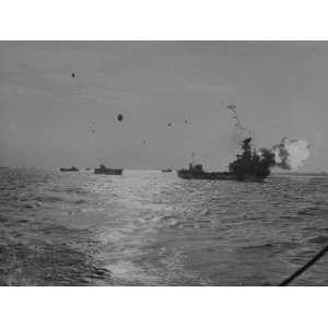 American Battleship Firing its Big Guns Photographic