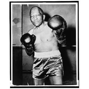 Jack Johnson, wearing boxing gloves and trunks,1946 Home