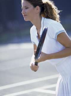 Side Profile of a Young Woman Playing Tennis Photographic Print at