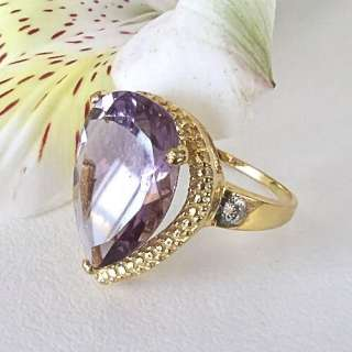 Elegant 9 Ct Pear Shaped Amethyst Diamond Accent Ring