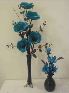 pair of teal and black silk flower arrangements in vase